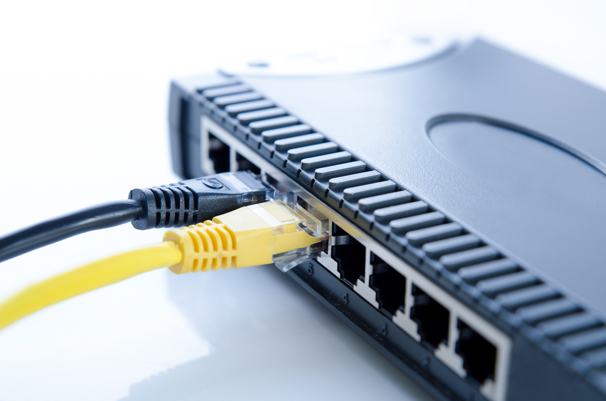 Network switch device and ethernet cables on white background